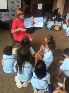 Sonia Lopez reading to the group of children from Treasure Island and CNC- Early Childcare Center.