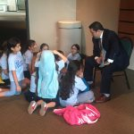 Joe Avila, Ford, reading to the children.